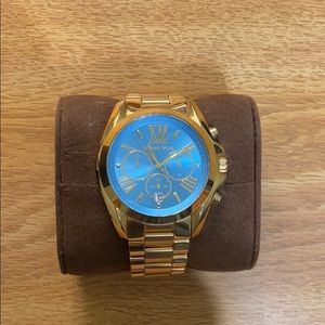 Michaels kors gold watch with blue face.